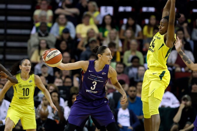 Phoenix Mercury's Diana Taurasi (3) passes the ball as Seattle Storm's Jewell Loyd, right, defends during the first half of Game 1 of a WNBA basketball playoffs semifinal Sunday, Aug. 26, 2018, in Seattle.