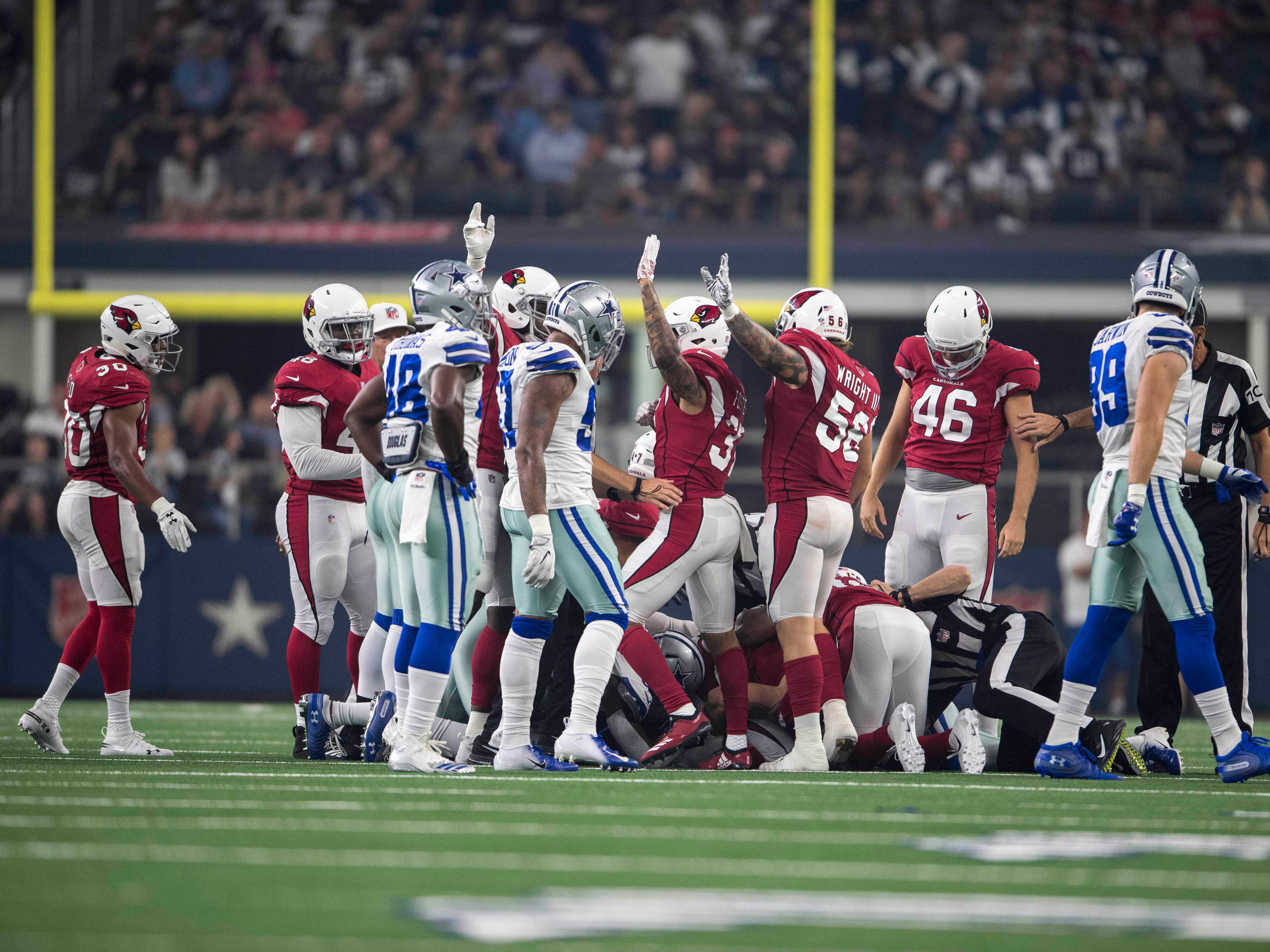 Aug 26, 2018; Arlington, TX, USA; The Arizona Cardinals celebrate recovering a fumble by Dallas Cowboys wide receiver Lance Lenoir (14) during the first quarter at AT&T Stadium.