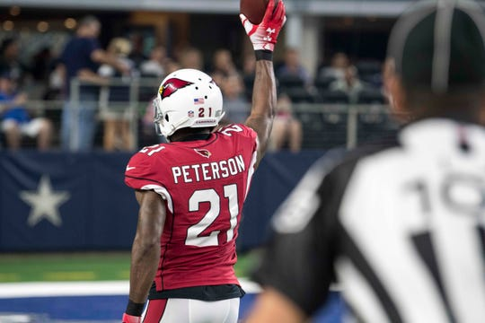 Aug 26, 2018; Arlington, TX, USA; Arizona Cardinals defensive back Patrick Peterson (21) after returning an interception for a touchdown against the Dallas Cowboys during the first quarter at AT&T Stadium. Mandatory Credit: Jerome Miron-USA TODAY Sports