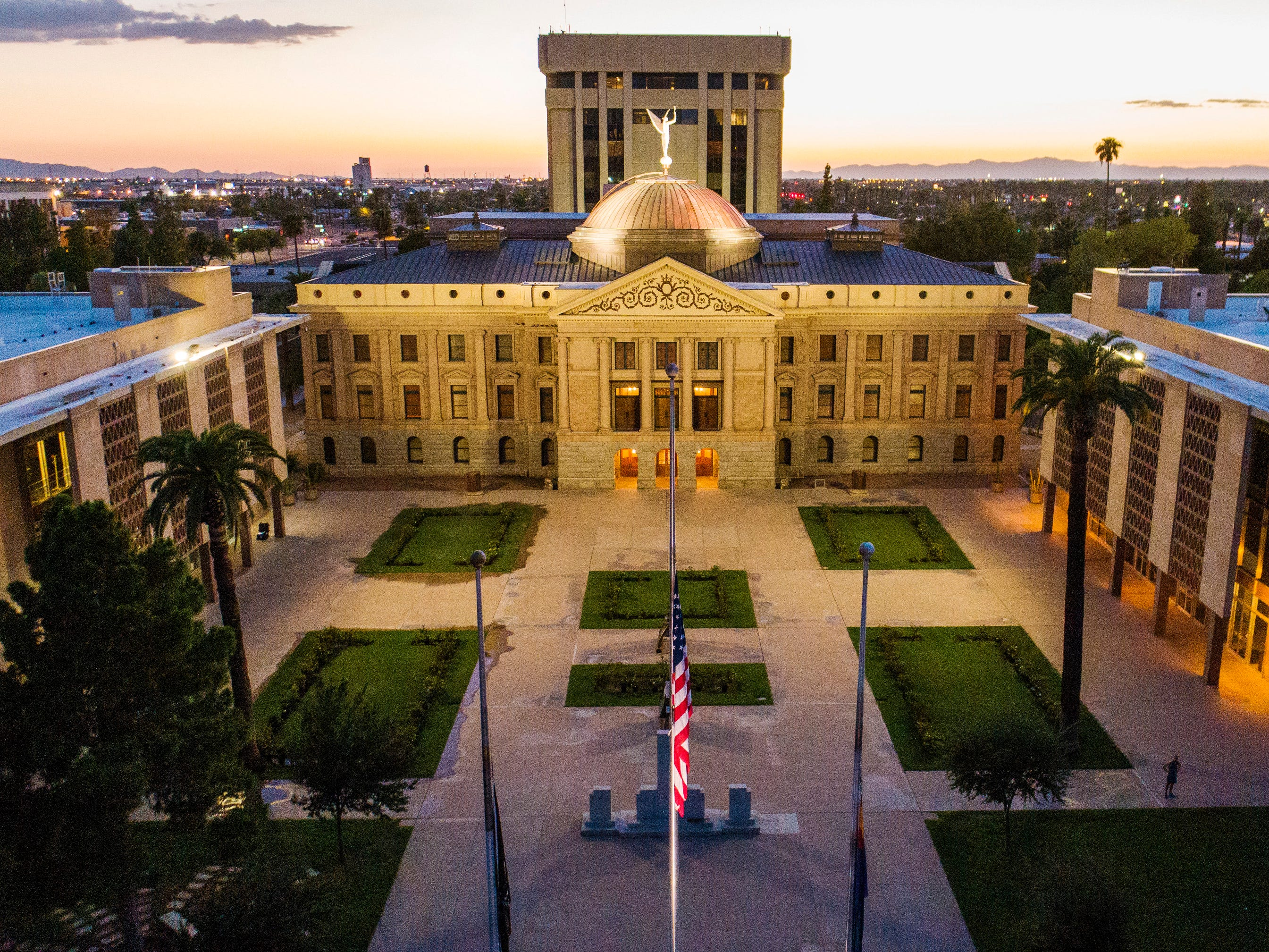 Flags are lowered to half staff at the Arizona capitol for Sen. John McCain in Phoenix, August 26. 2018. The six-term Arizona senator died Saturday at age 81.