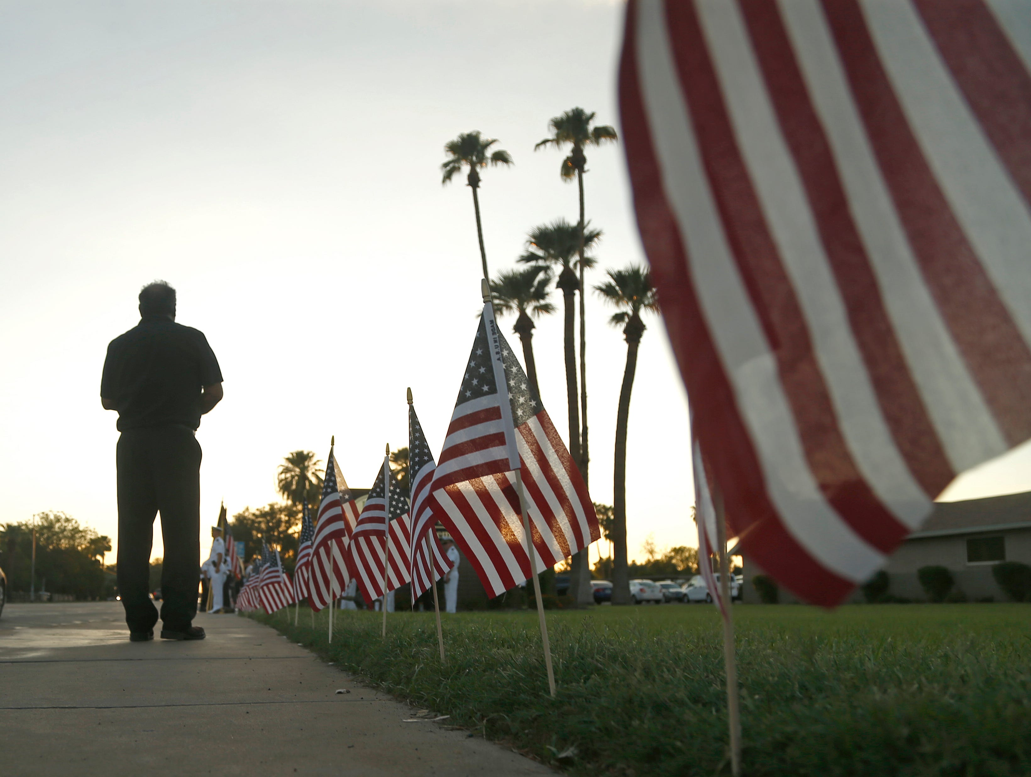 Flags line a memorial outside A.L. Moore-Grimshaw Mortuaries in Phoenix on Aug. 26, 2018.