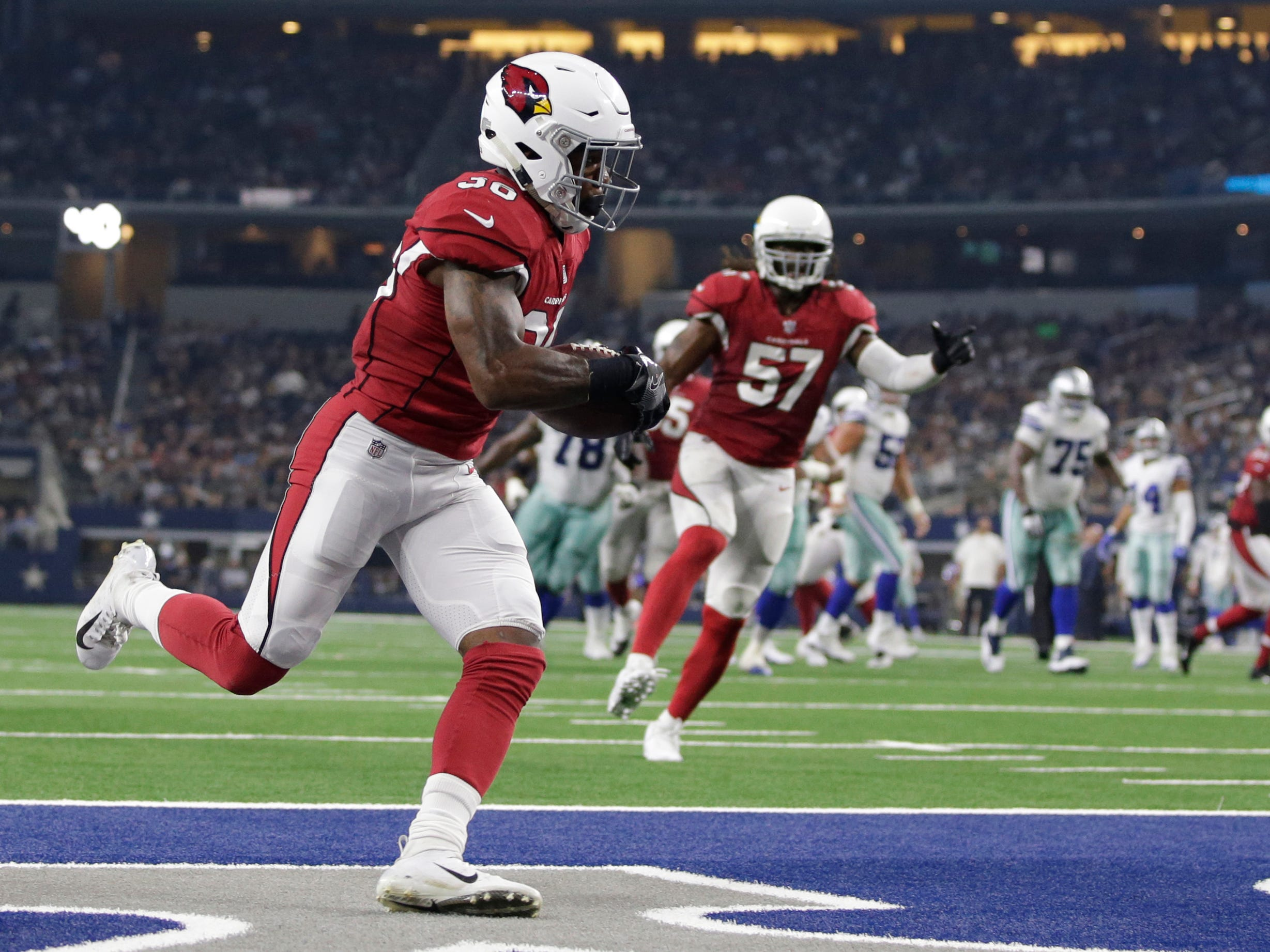 Aug 26, 2018; Arlington, TX, USA; Arizona Cardinals defensive back Budda Baker (36) returns an interception in the second quarter against the Dallas Cowboys at AT&T Stadium. Mandatory Credit: Tim Heitman-USA TODAY Sports