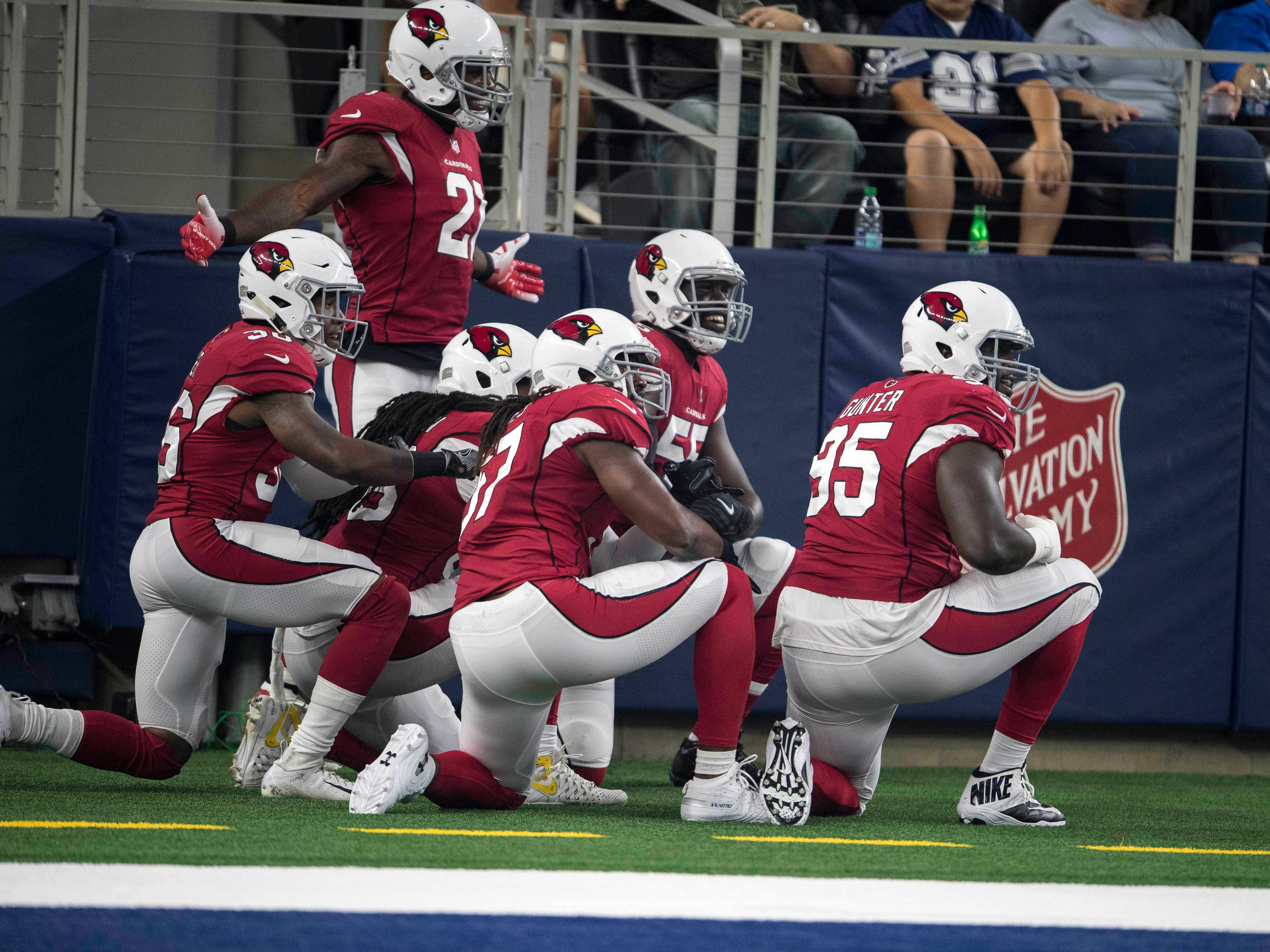 Aug 26, 2018; Arlington, TX, USA; Arizona Cardinals defensive back Patrick Peterson (21) and defensive tackle Rodney Gunter (95) and linebacker Josh Bynes (57) and defensive end Chandler Jones (55) celebrate a touchdown by Peterson against the Dallas Cowboys during the first quarter at AT&T Stadium. Mandatory Credit: Jerome Miron-USA TODAY Sports