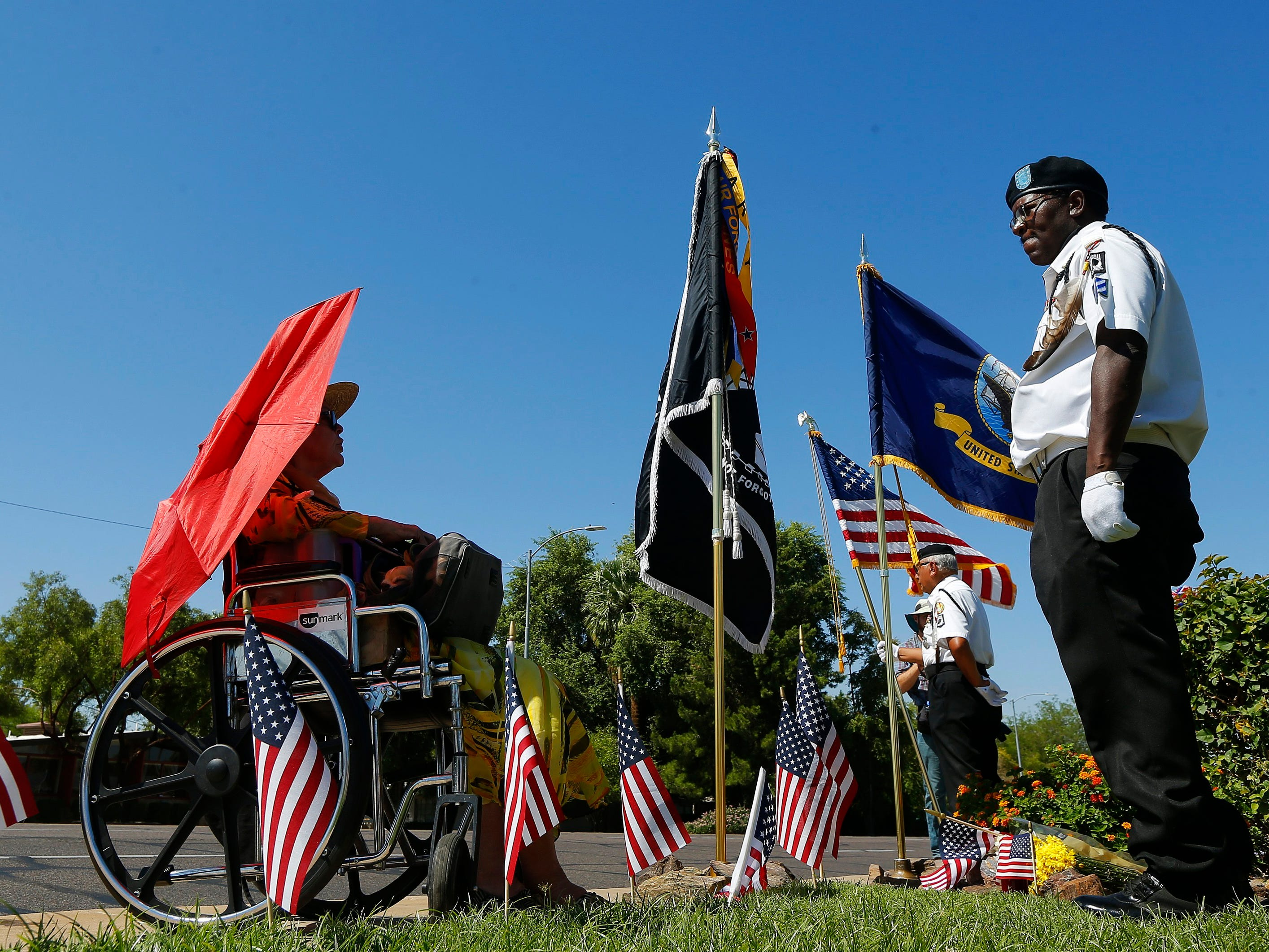 Members of the POW-MIA-KIA Honor Guard stand watch in honor of the late Arizona Republican Sen. John McCain at the local mortuary where he is being kept Aug. 27, 2018, in Phoenix.