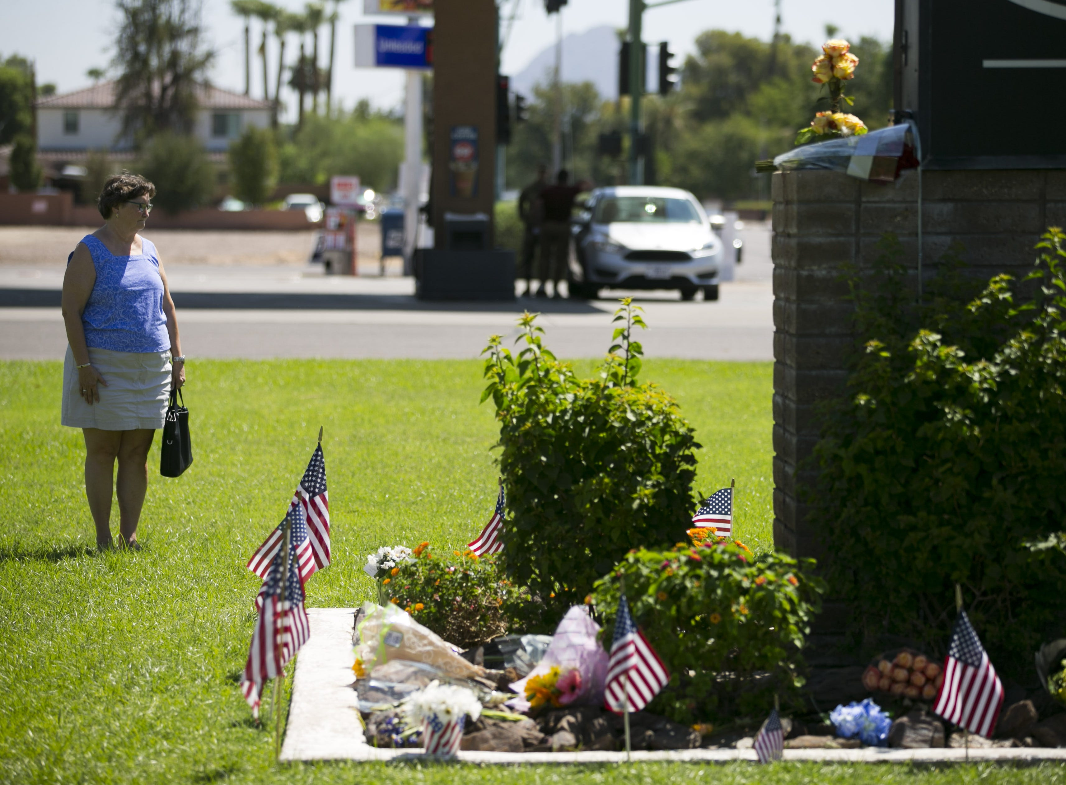 Patty Young of Phoenix, looks at a memorial for Sen. John McCain at A.L. Moore-Grimshaw Mortuaries in Phoenix, on Aug. 27, 2018.