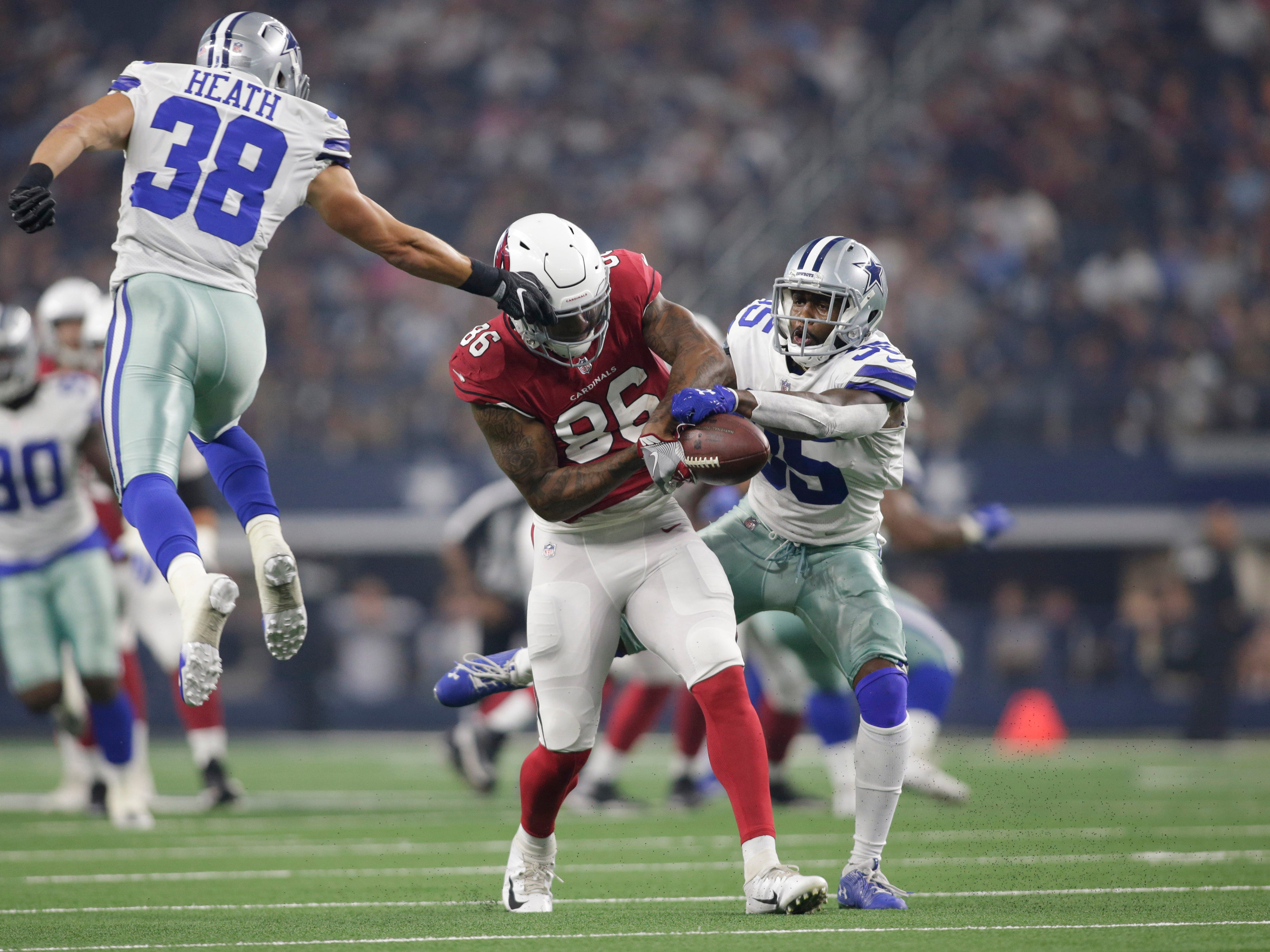 Aug 26, 2018; Arlington, TX, USA; Dallas Cowboys defensive back Kavon Frazier (35) breaks up a pass against Arizona Cardinals tight end Ricky Seals-Jones (86) in the first quarter at AT&T Stadium.