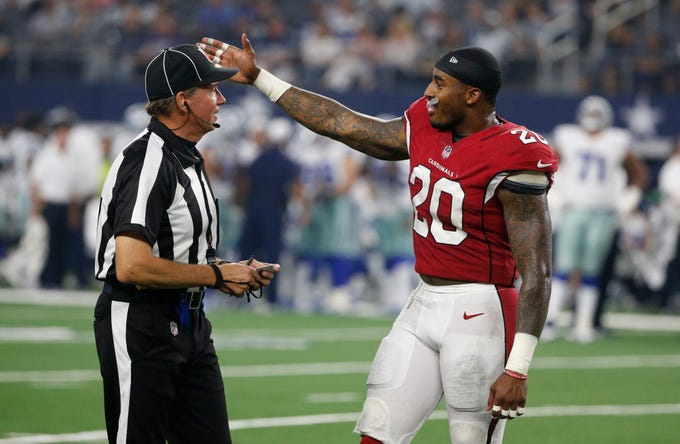 Arizona Cardinals linebacker Deone Bucannon (20) argues a call during the first half of a preseason NFL football game in Arlington, Texas, Sunday, Aug. 26, 2018. (AP Photo/Michael Ainsworth)