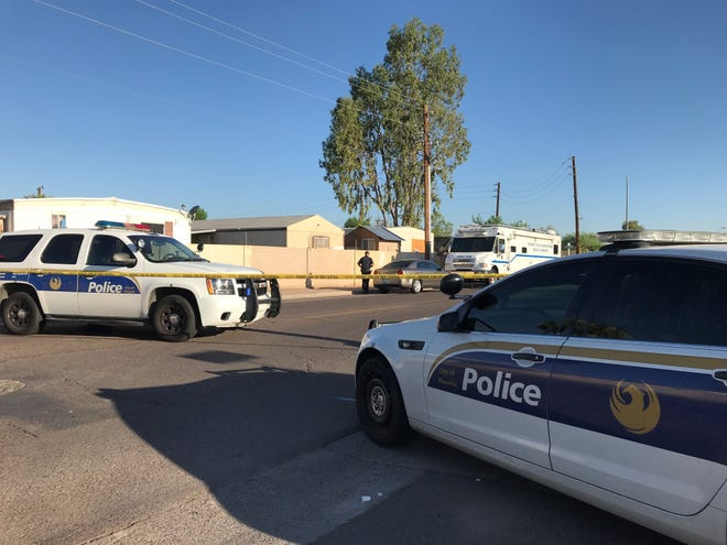 The scene of the shooting near 39th Ave. and Roosevelt St. on Monday.