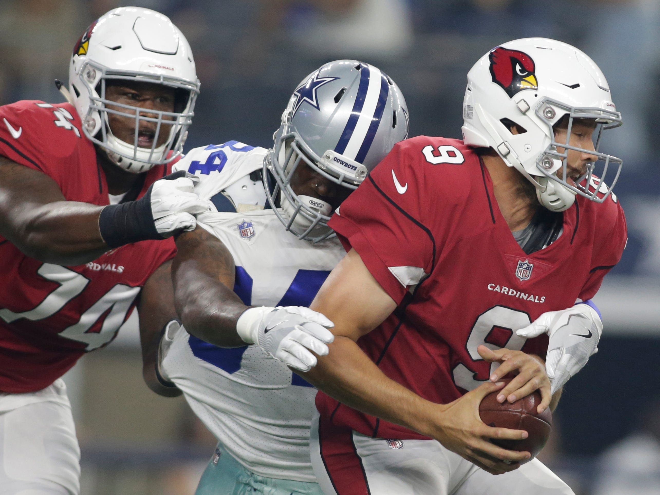 Aug 26, 2018; Arlington, TX, USA; Dallas Cowboys defensive end Randy Gregory (94) sacks Arizona Cardinals quarterback Sam Bradford (9) in the first quarter at AT&T Stadium.