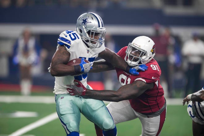 Aug 26, 2018; Arlington, TX, USA; Arizona Cardinals defensive end Benson Mayowa (91) tackles Dallas Cowboys running back Rod Smith (45) during the first quarter at AT&T Stadium. Mandatory Credit: Jerome Miron-USA TODAY Sports