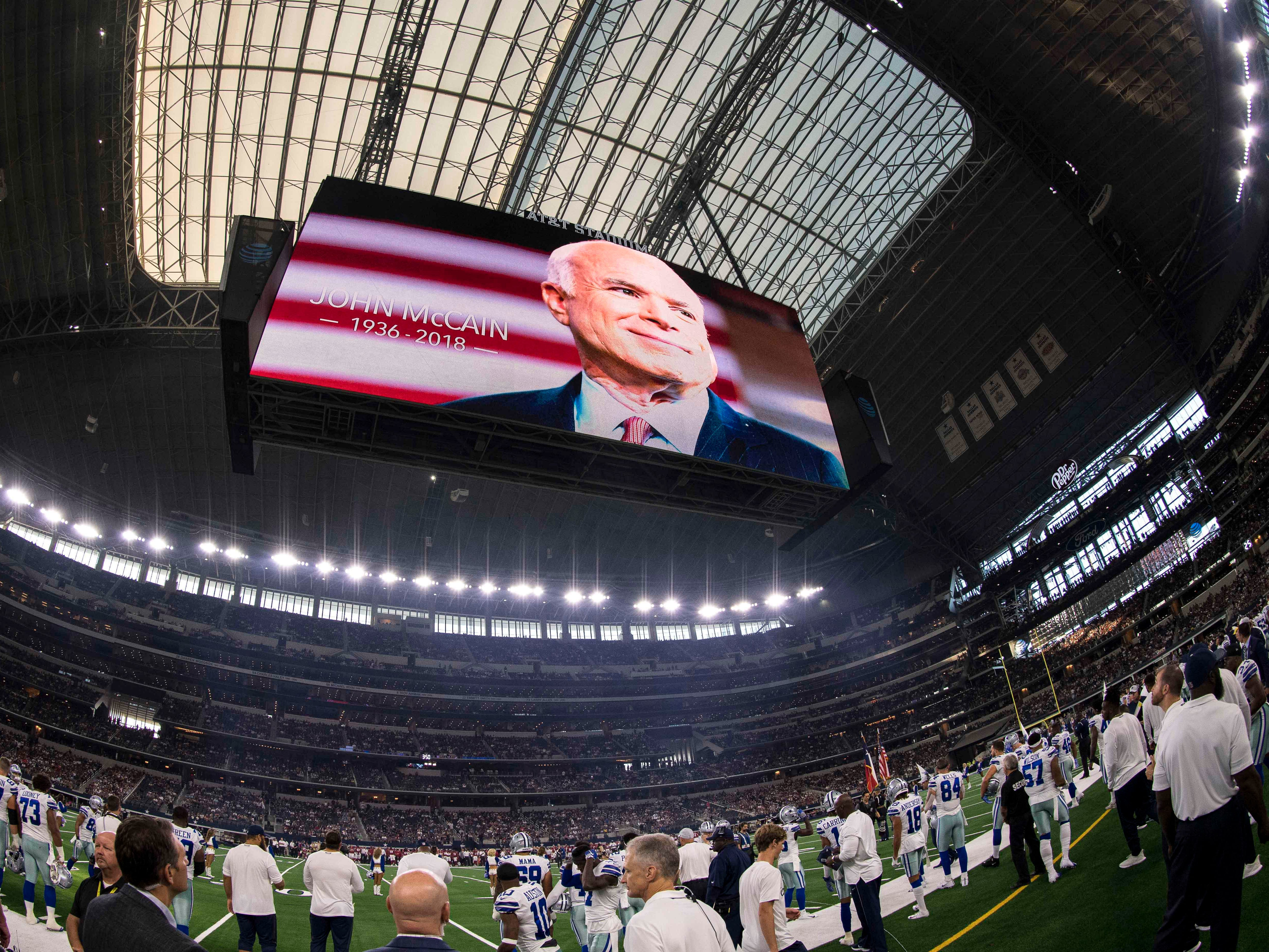 Aug 26, 2018; Arlington, TX, USA; The Dallas Cowboys and Arizona Cardinals observe a moment of silence in honor of Arizona senator John McCain before the game at AT&T Stadium.
