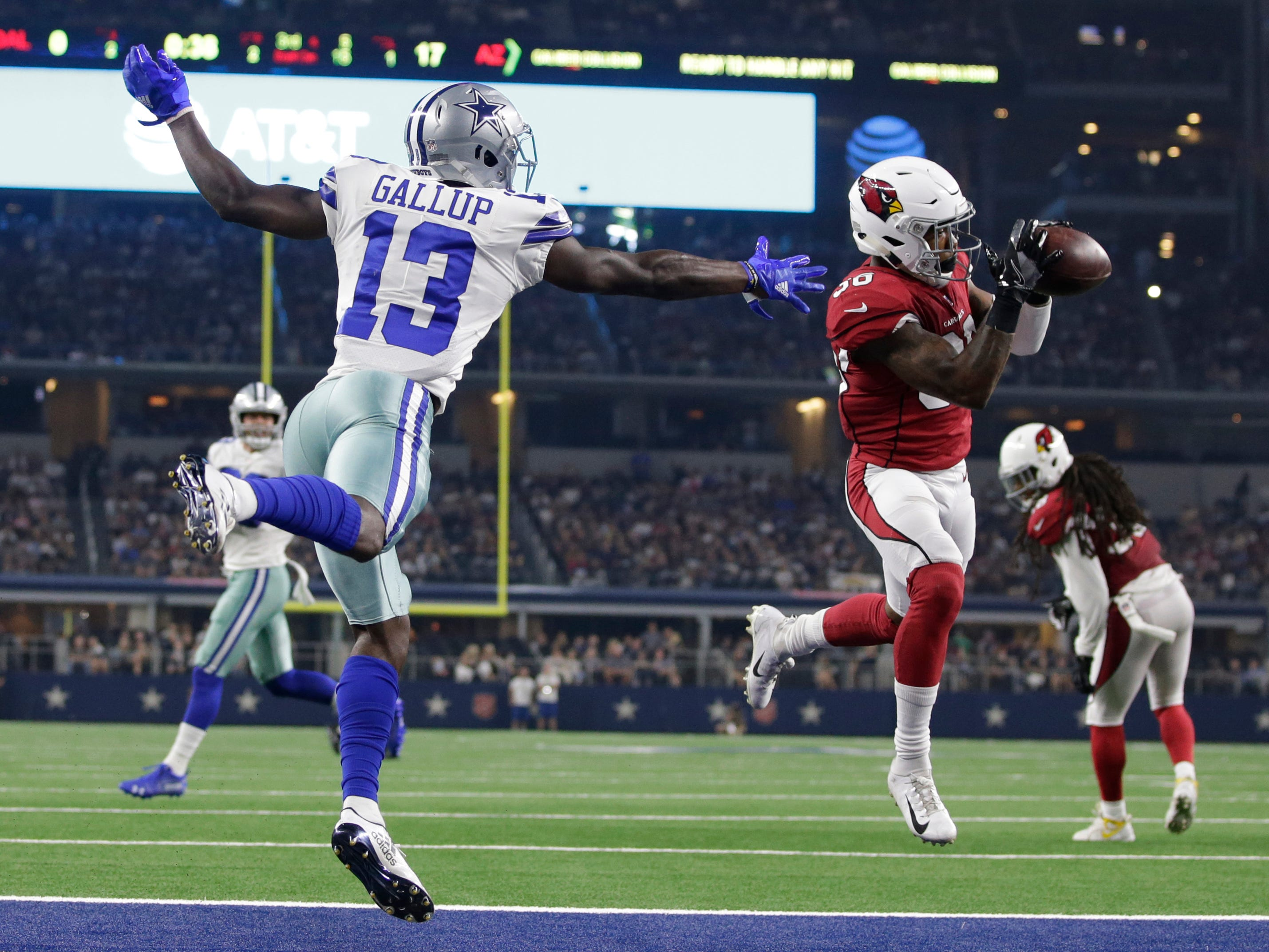 Aug 26, 2018; Arlington, TX, USA; Arizona Cardinals defensive back Budda Baker (36) intercepts a pass intended for Dallas Cowboys wide receiver Michael Gallup (13) in the second quarter at AT&T Stadium. Mandatory Credit: Tim Heitman-USA TODAY Sports