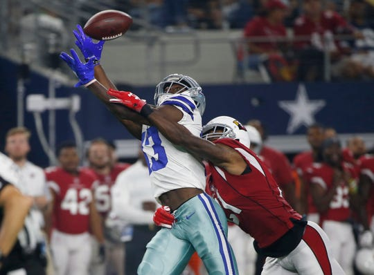 Dallas Cowboys wide receiver Michael Gallup (13) can't get to the ball as Arizona Cardinals defensive back Patrick Peterson (21) defends during the first half of a preseason NFL football game in Arlington, Texas, Sunday, Aug. 26, 2018. (AP Photo/Ron Jenkins)