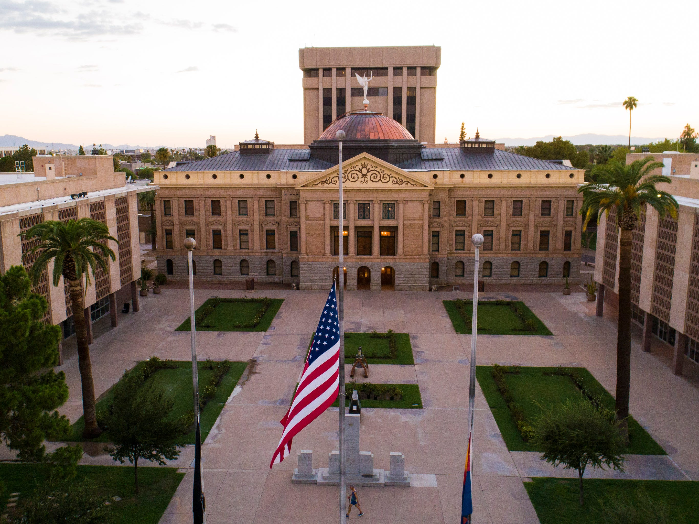 Flags are lowered to half staff at the Arizona capitol for Sen. John McCain in Phoenix, Aug. 26. 2018. The six-term Arizona senator died Saturday at age 81.