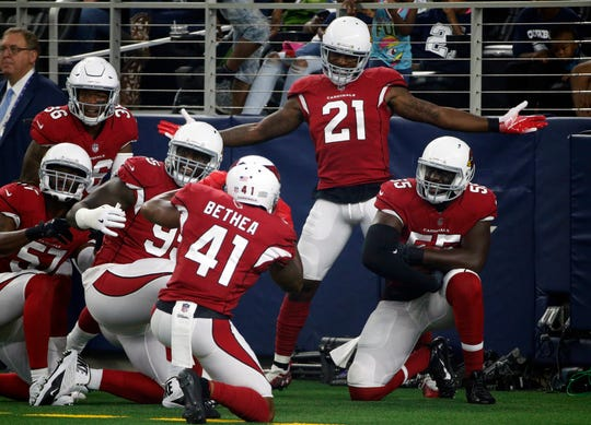 Arizona Cardinals defensive back Patrick Peterson (21) celebrates after scoring a touchdown on an interception during the first half of a preseason NFL football game against the Dallas Cowboys in Arlington, Texas, Sunday, Aug. 26, 2018. (AP Photo/Michael Ainsworth)
