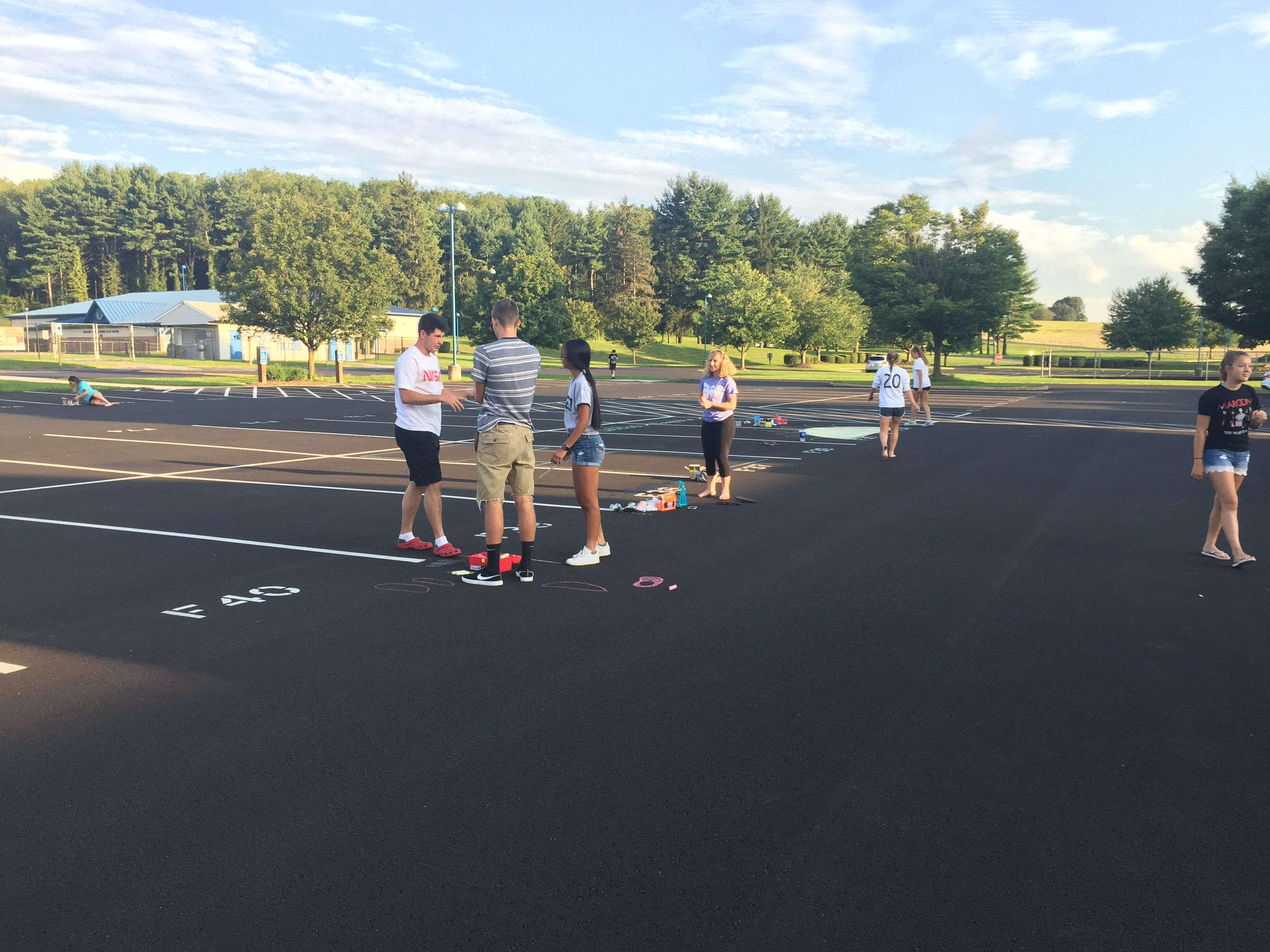 Cedar Crest High School seniors took out the chalk and decorated their parking spots on Saturday evening in preparation for the new school year. This is the second year, seniors have decorated their parking spots.