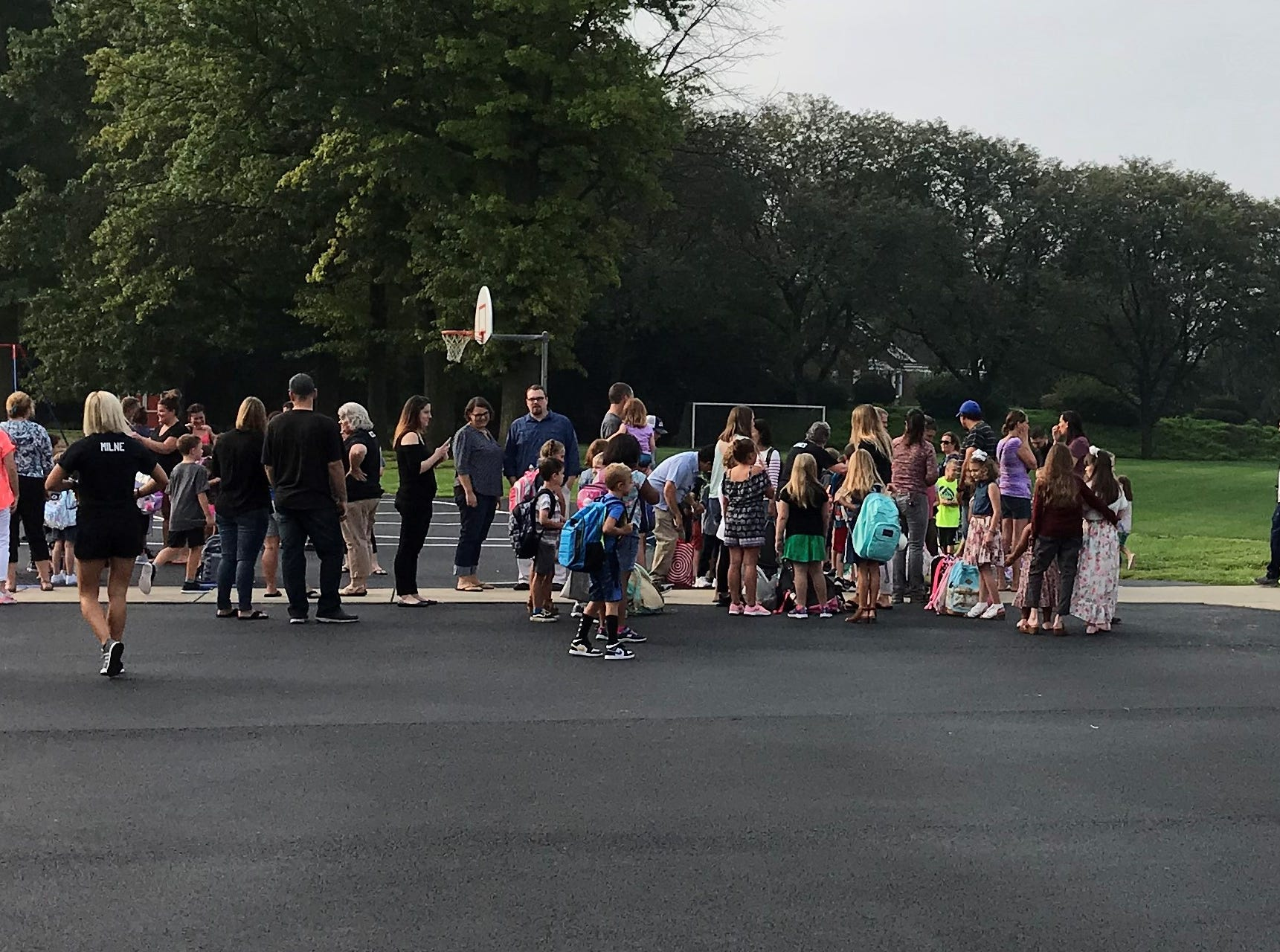 Students at Pine Street Elementary School gather on the playground in preparation for the first day of school.