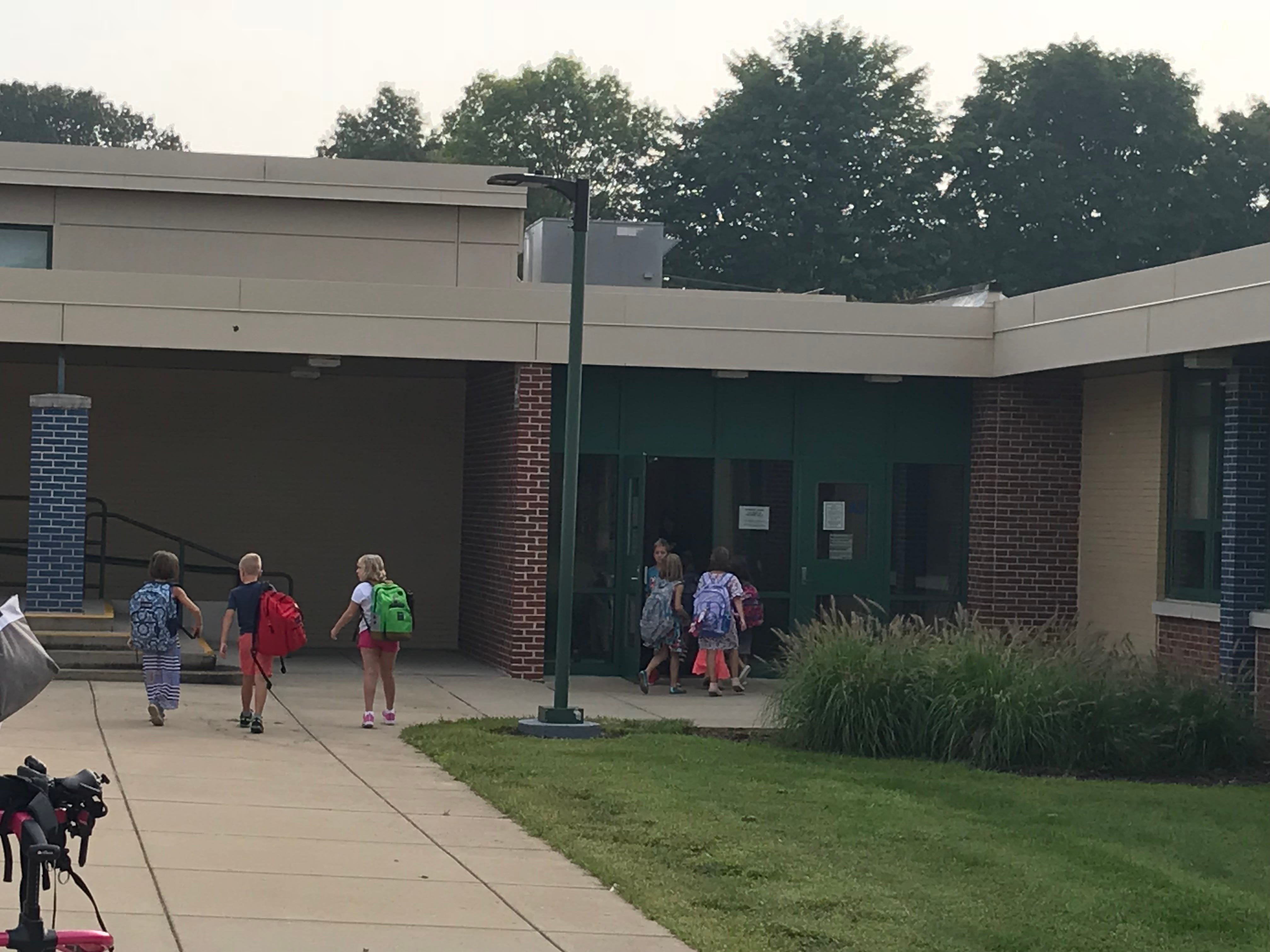 Students enter Pine Street Elementary School in Palmyra for their first day of school.