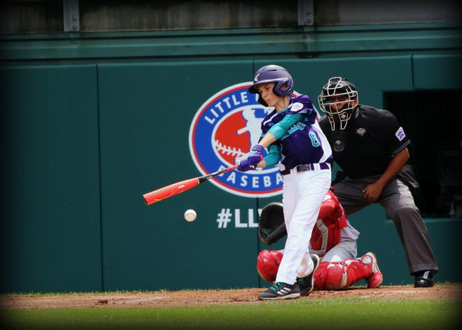 Zachary Freer takes a mighty cut at a pitch against Japan during the Little League World Series.
