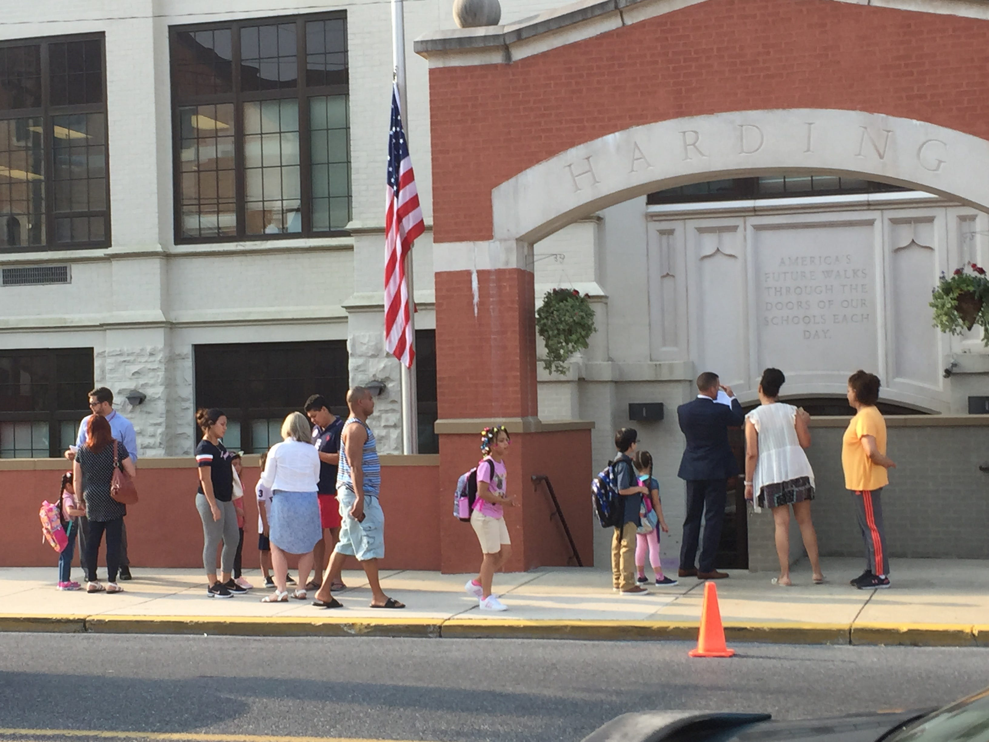 Students stream in for the first day of school at Harding Elementary on Monday, Aug. 27.