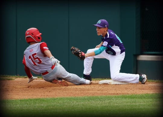 Zachary Freer applying the tag at third base during the Little League World Series.