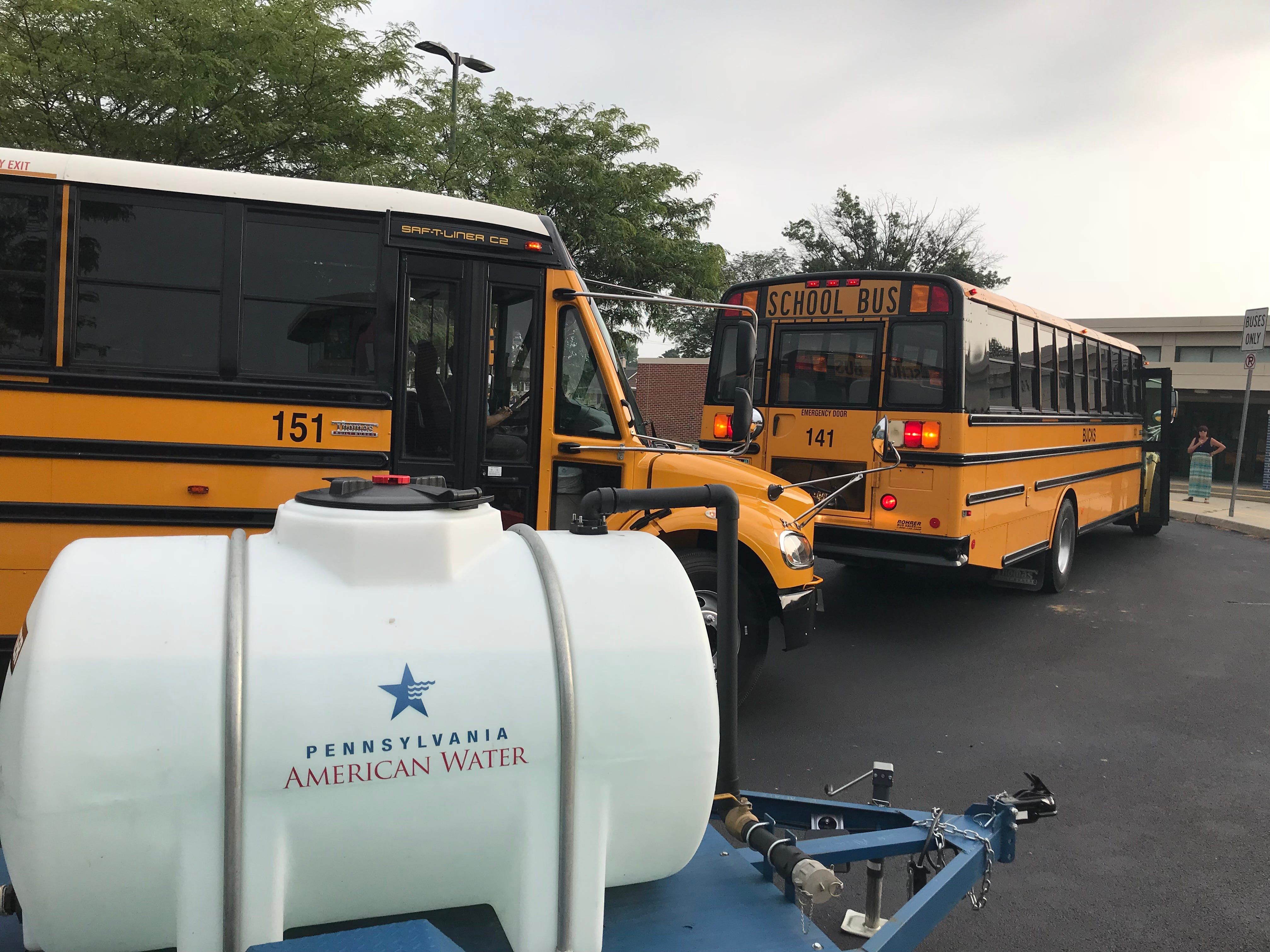 School buses drop off students at Pine Street Elementary School for the first day of school.