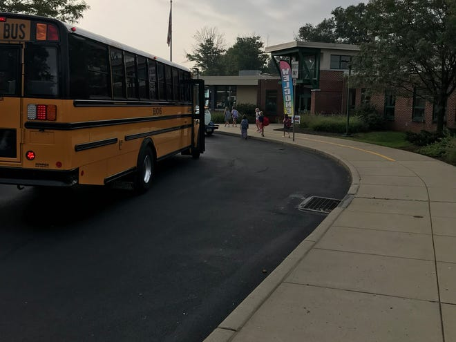 A school bus drops off students at Pine Street Elementary School in Palmyra.