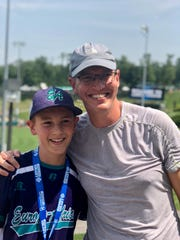 Zachary Freer (left) and his father, Peter, a Lebanon native, pose at the Little League World Series in Williamsport.