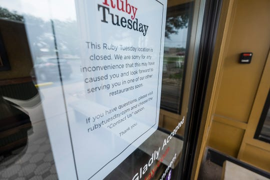 A sign on the door of Ruby Tuesday by the Birchwood Mall in Fort Gratiot tells customers that the restaurant has closed.