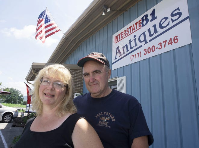 Steven Hoffman and his wive, Brenda, pose in front of their new business, Interstate 81 Antiques, 15, Hershey Road, Shippensburg. The store will hosts flea markets on Saturdays.