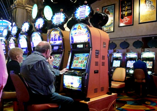 Patrons play slot machines at Hollywood Casino in Grantville, near Harrisburg, Friday, August 24, 2018. The casino is operated by Penn National Gaming, which may open a mini-casino in York County. Bill Kalina photo