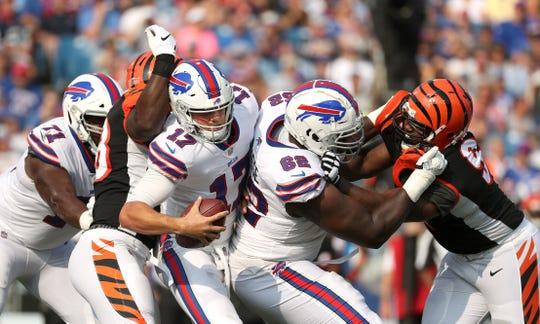 Bills quarterback Josh Allen (17)  has the pocket collapse on him for sack against the Bengals.