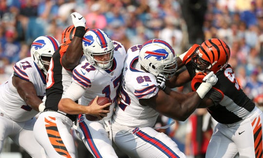 Bills quarterback Josh Allen (17)  has the pocket collapse on him for sack against the Bengals.