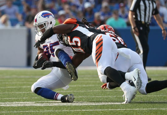 Bills tight end Charles Clay is tackled after catch over the middle.