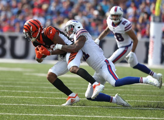 Bills Jordan Poyer tackles Bengals receiver Tyler Boyd after a catch.