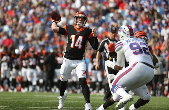 Bengals quarterback Andy Dalton looks for a short pass.