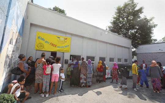 Families lined up around the parking lot Saturday for free backpacks at Barakah Muslim Charity on Jefferson Avenue.