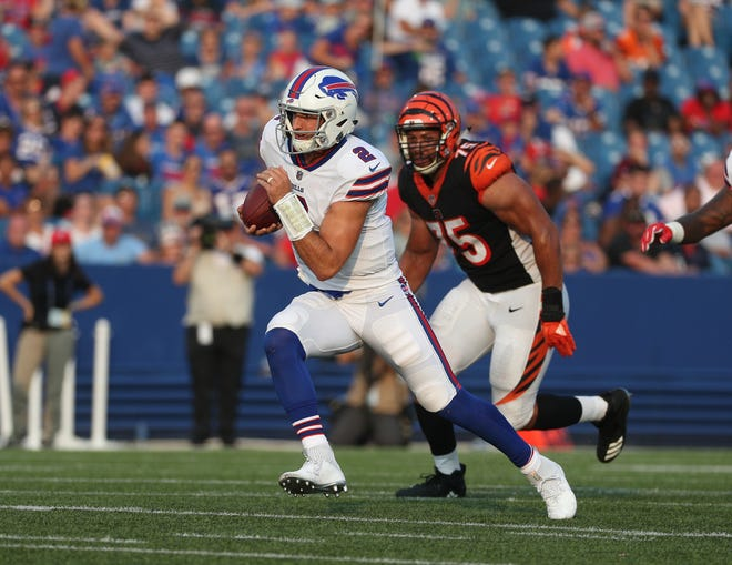 Bills quarterback Nathan Peterman scrambles for a first down against the Bengals.