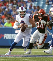 Bills quarterback Nathan Peterman escapes the pass rush against the Bengals.