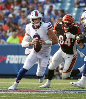 Bills quarterback Nathan Peterman escapes the pass rush against the Bengals.