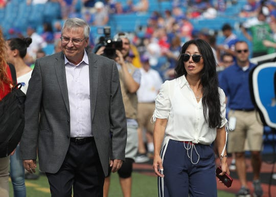 Terry and Kim Pegula on the field before the game against the Bengals.