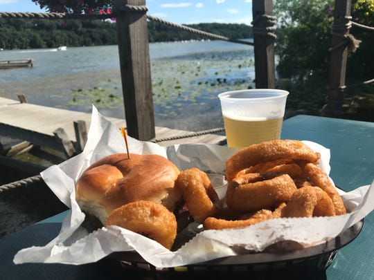 A burger, onion rings and beer at the Bayside Pub in Webster.