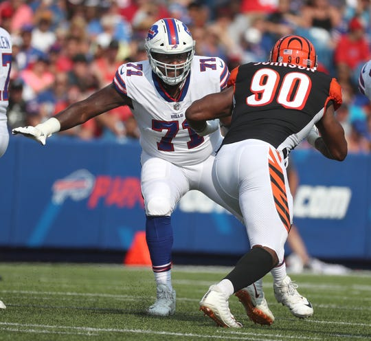 Bills offensive lineman Marshall Newhouse blocks Bengals Michael Johnson.