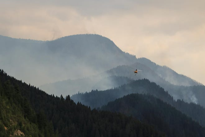 Fire burning above Cougar Reservoir. This photo does not show the illegal drone.