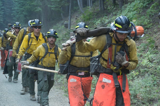 Crews on the Miles Fire August 21.