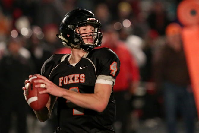 Silverton's Levi Nielsen (4) looks to pass in the Thurston vs. Silverton football game in the first round of the OSAA class 5A playoffs at Silverton High School on Friday, Nov. 3, 2017. Silverton won the game 31-14.