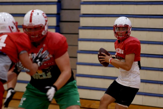 Elijah Enomoto-Haole practices with the South Salem football team inside as wildfire smoke lingers over the Willamette Valley at South Salem High School on Thursday, Aug. 23, 2018.