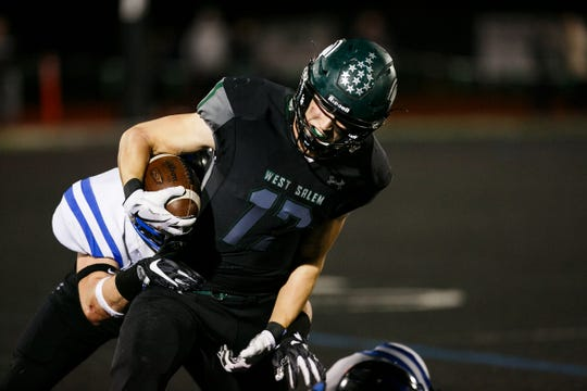 West Salem's Micah Pugh (17) is tackled by South Medford in an OSAA 6A quarterfinal game on Friday, Nov. 17, 2017, at West Salem High School. South Medford won the game 28-14.