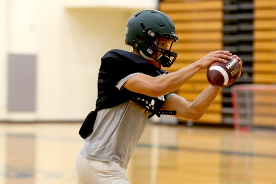 Simon Thompson practices with the West Salem football team inside as wildfire smoke lingers over the Willamette Valley at West Salem High School on Monday, Aug. 20, 2018.