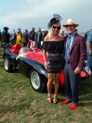 Jill Barnes of Laguna Beach chose her outfit to complement the 1955 Ferrari 500 Mondial Scaglietti Spyder owned by her fiancé Thomas Peck, of Irvine at the 68th annual Pebble Beach Concours held Sunday on the 18th fairway at the Pebble Beach Golf Links. The annual display of fine automobiles has grown into a rolling fashion show of attendees who often vie with the fine automobiles for attention.